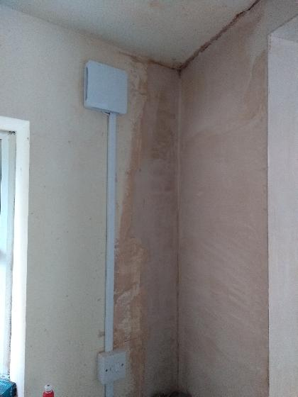 Extractor fan installed to newly formed  kitchen within one of the rooms.