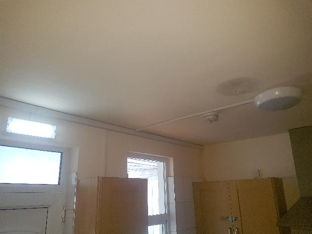 Kitchen sensor light, emergency light, heat detector and part of surface mounted trunking installed.