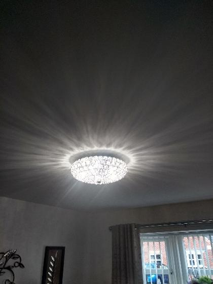 Transformation from a basic light pendent changed for a customer's own light fitting