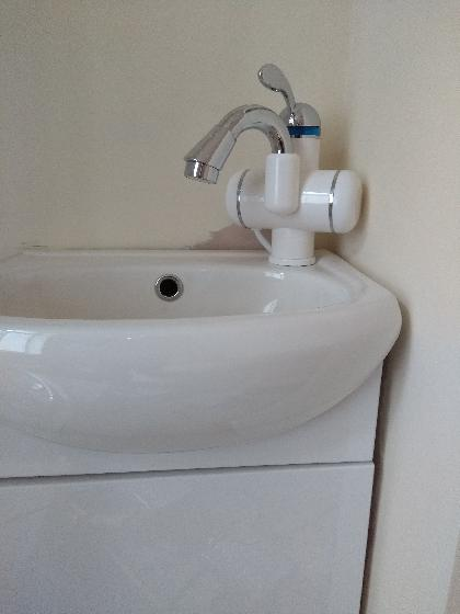 Individual room electric hot water tap for hand basin's.